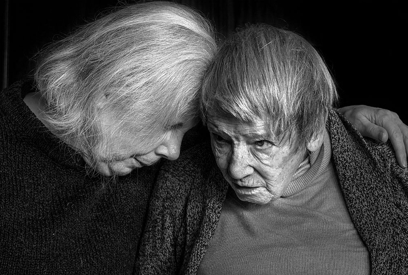 Black and white image of a mother and daughter by Natasha Balogh