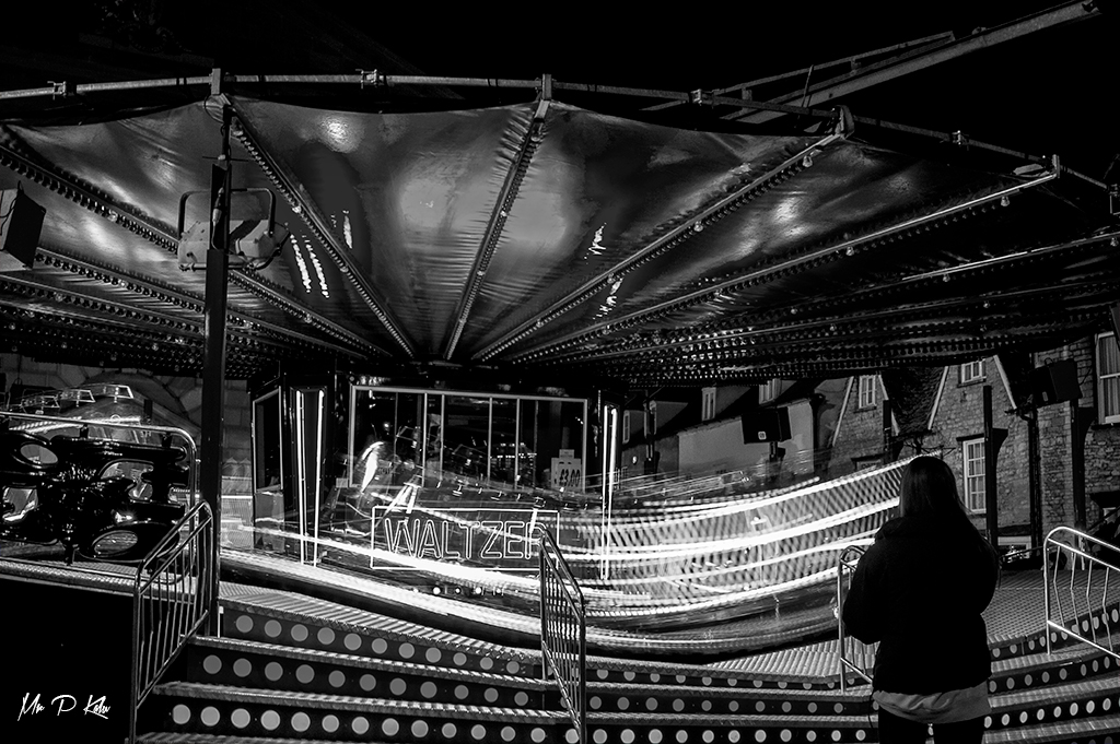 Image of a young lady waiting for her ride on the 'Waltzer' in the annual Woodstock funfair