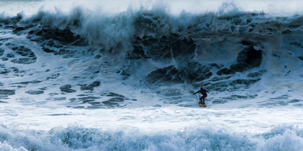 Surfer riding the waves on Nazare Beach Portugal taken by MrPKalu