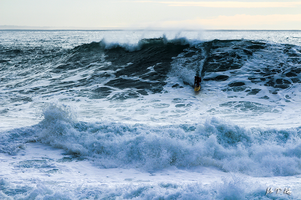 Image of a surfer on Nazare Beach