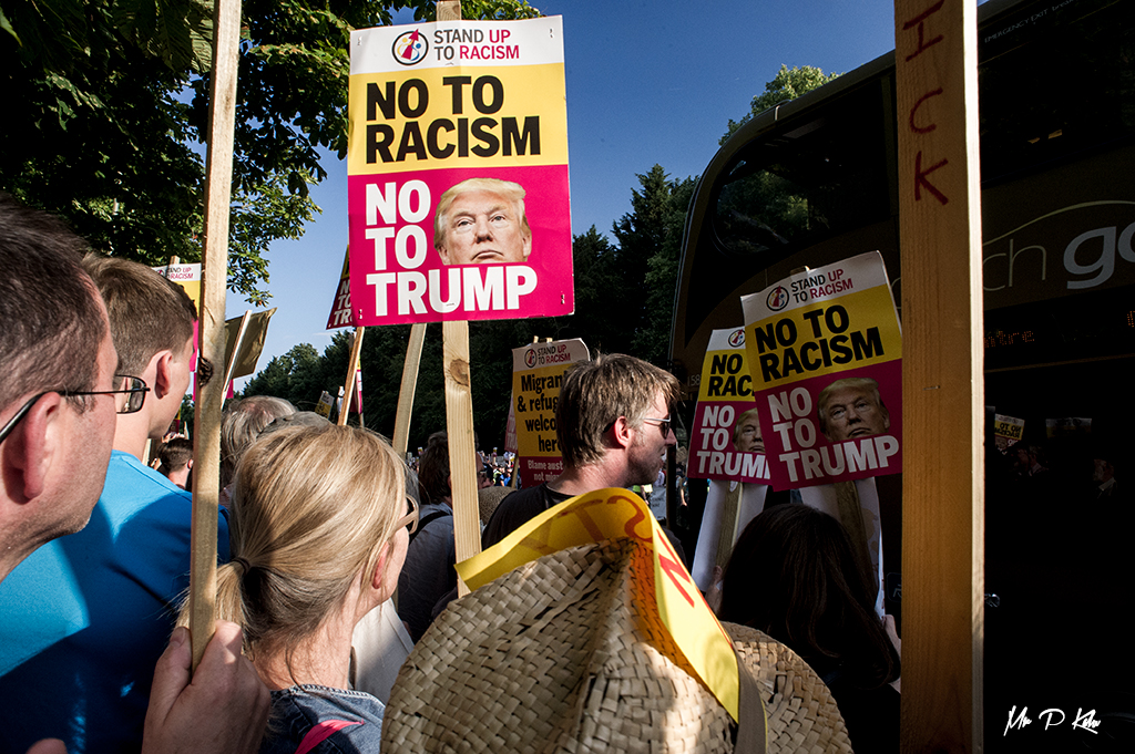 'No to racism' placard held by a protester during the President Trump visit to Blenheim Palace on 12 July 2018