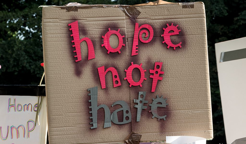 'Hope not Hate' placard held aloft during the President Trump visit to Blenheim Palace in Woodstock, Oxfordshire