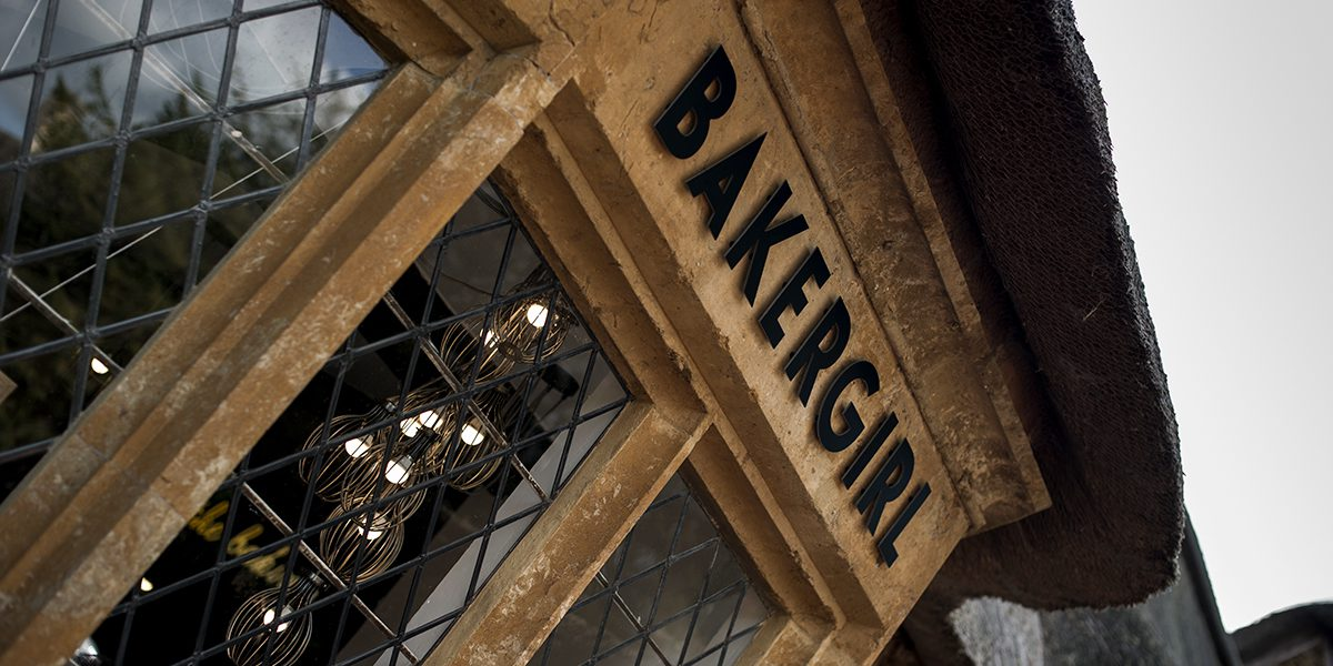 Bakergirl cafe signage in Great Tew Oxfordshire Cotswolds