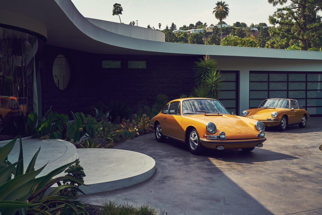 Two Porsche's parked outside a Hollywood House