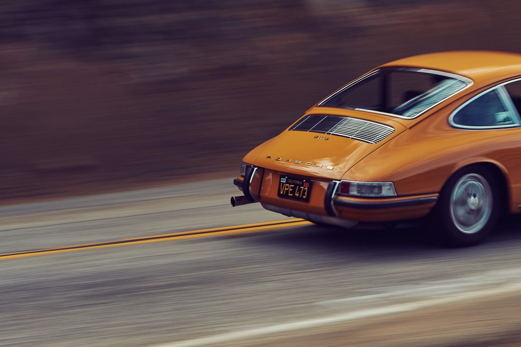 Rear end of a Porsche 911S in motion